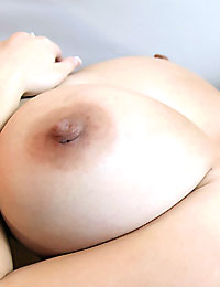 Big breasted September shows her big juggs and pink pussy